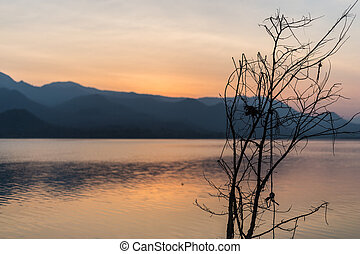 Sunset with lake and mountain landscape