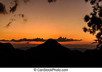 Sunset with mountain silhouette