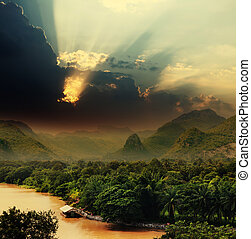 Sunset with rays over river