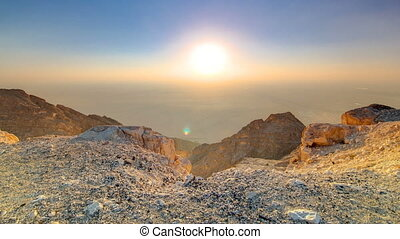 Sunset with rocks timelapse. Jebel Hafeet is a mountain located primarily in the environs of Al Ain and offers an impressive view over the city.