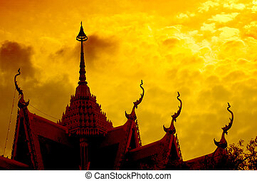 Dramatic sunset with buddhist temple silhouette, Thaialnd