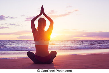 Sunset Yoga - Young healthy woman practicing yoga on the...