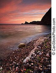 sunseton, przedimek określony przed rzeczownikami, ocean, plaża