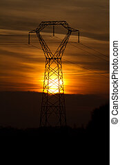 sunsey behind electricity pylon - sunsetting behind an ...