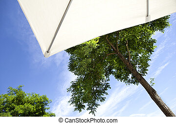 Sunshade on a terrace overlooking the trees