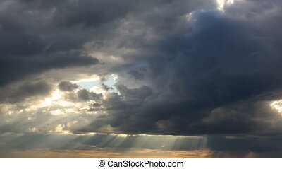 Sunshine Breaks Through Clouds at Sunset