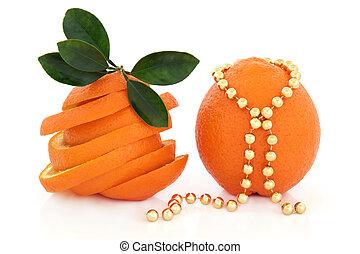 Sunshine Fruit - Orange fruit sliced with leaf sprigs and...