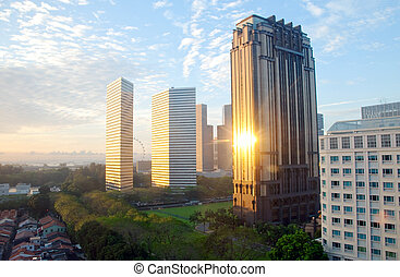 sunshine hits a building in downtown singapore