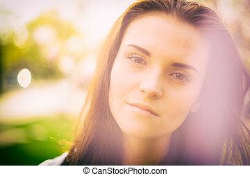 Sunshine outdoor portrait of pretty girl