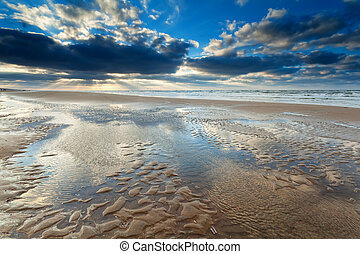 sunshine over North sea beach at low tide