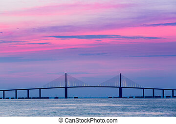 Sunshine Skyway Bridge at dawn - Brilliant sunrise lights up...
