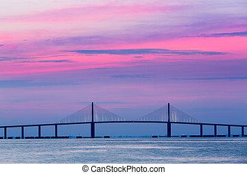 Sunshine Skyway Bridge at dawn - Brilliant sunrise lights up...