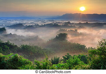 Sunshine with mountain , cloud and fog in the morning