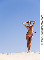 Suntanned woman - Portrait of suntanned woman standing on...