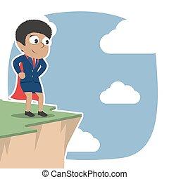 Super african businesswoman standing on cliff edge
