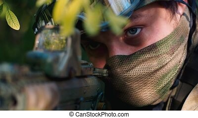 Super close-up of a soldier, his eyes looking at gunpoint