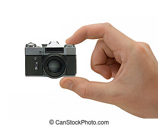 Super compact camera in hand, isolated on white background