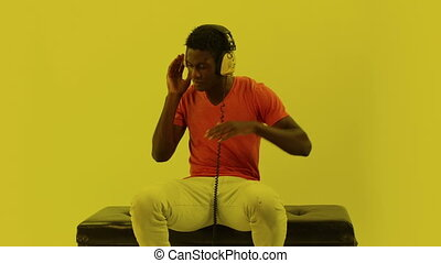 super cool young guy dances and poses with headphones