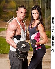 Super fit couple. - Portrait of an attractive super fit...