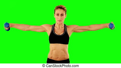 Super fit woman lifting dumbbells i