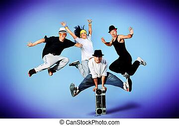 super fly - Group of modern dancers dancing hip-hop at...