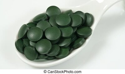 Super food vitamins and minerals in spirulina for vegetarians and a healthy life. On a white background close-up