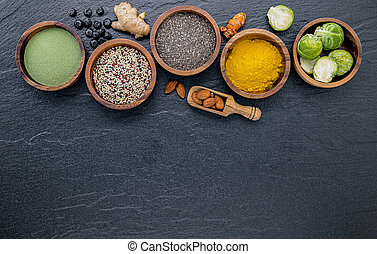 Super foods on in wooden bowl. Selection food and healthy food set up on dark stone background.