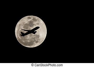 Super full moon over Thailand and silhouette of airplane