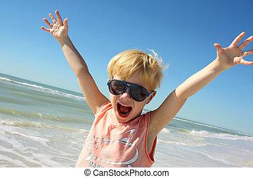 Super Happy Boy on Beach by Ocean