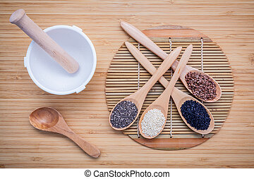 Super healthy of seeds selection flax seed, chia seed ,black sesame and white sesame in wooden spoon