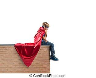 Concept of fantasy of a super hero child