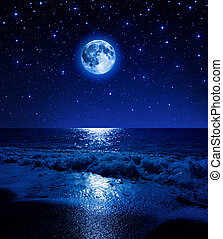 super moon in starry sky on sea beach