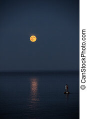 Super moon over the ocean in Southwest Harbor Maine