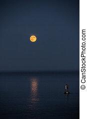 Super moon over the ocean in Southwest Harbor Maine