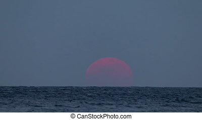 Super moon over the ocean in Spain, 31. January 2018