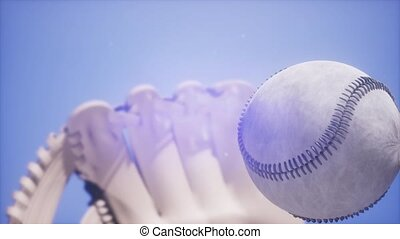 Super slow motion Baseball and mitt at blue sky background