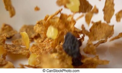 Super slow motion close shot of corn flakes with fruits and...