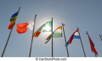 Super slow motion - colorful flags fluttering in the wind - politics concept