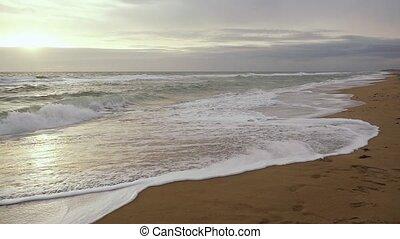 Super Slow Motion Foam Waves Falls on Sand