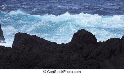 Super slow motion of ocean near volcanic rocks - Super slow...