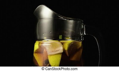 Super slow motion sangria carafe in motion