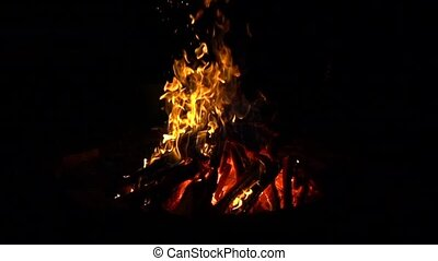 Super slow motion shot of a bonfire in the dark