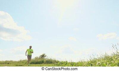 Super slow motion shot of a handsome athletic runner
