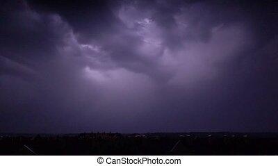 Super slow motion shot of a heavy lightning strike at night
