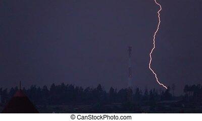 Super slow motion shot of a heavy lightning strike near cell...