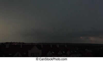 Super slow motion shot of a multiple lightning strikes in residential area at night