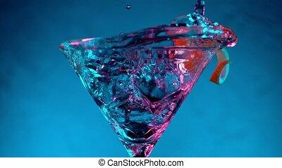 Super Slow motion shot of ice cube splashing into Dry Martini Drink.