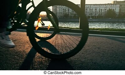 Super slow motion shot of people cycling along city...