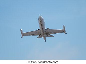 Super sonic military jet in flight over blue sky