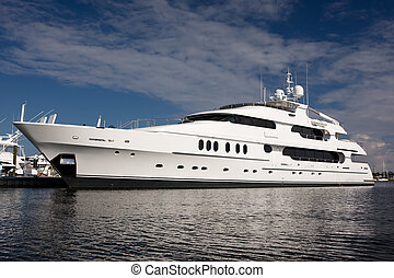 super yacht - large white private mega yacht alongside dock
